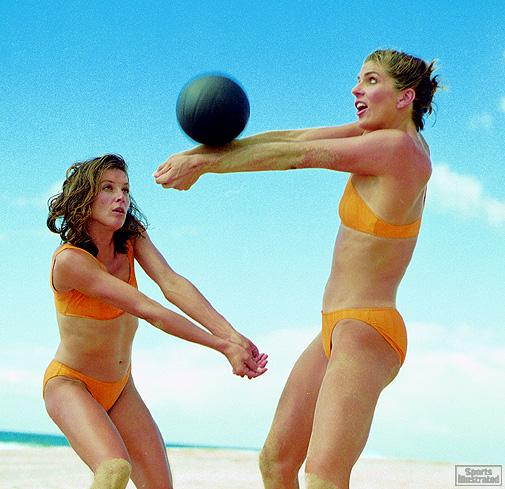 Linda Hanley (left) backs up her partner.  Karri Poppinga returns a serve