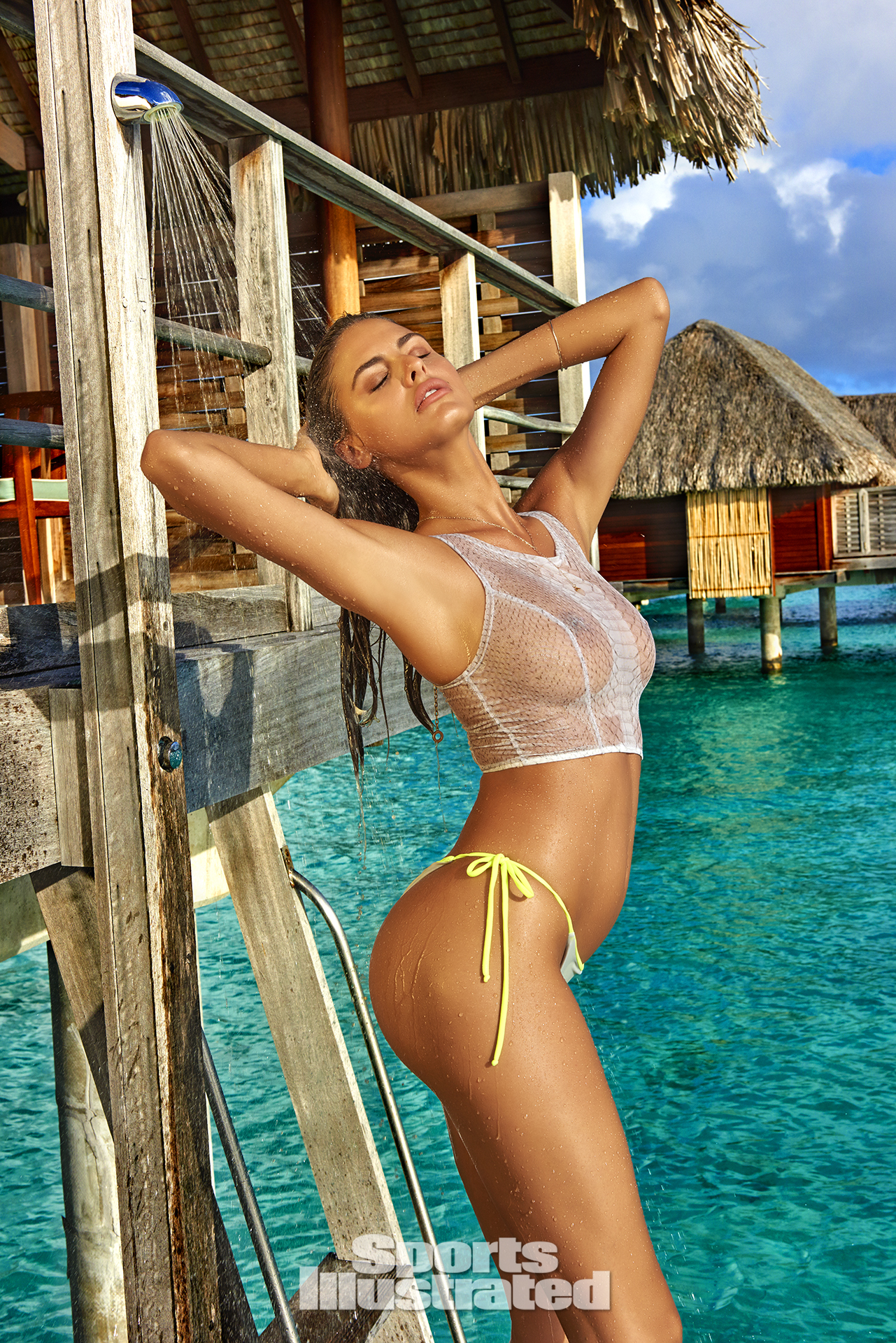 Bo Krsmanovic was photographed by Yu Tsai in the Islands of Tahiti. Top by eskini. Swimsuit by Kai Lani Swimwear.
