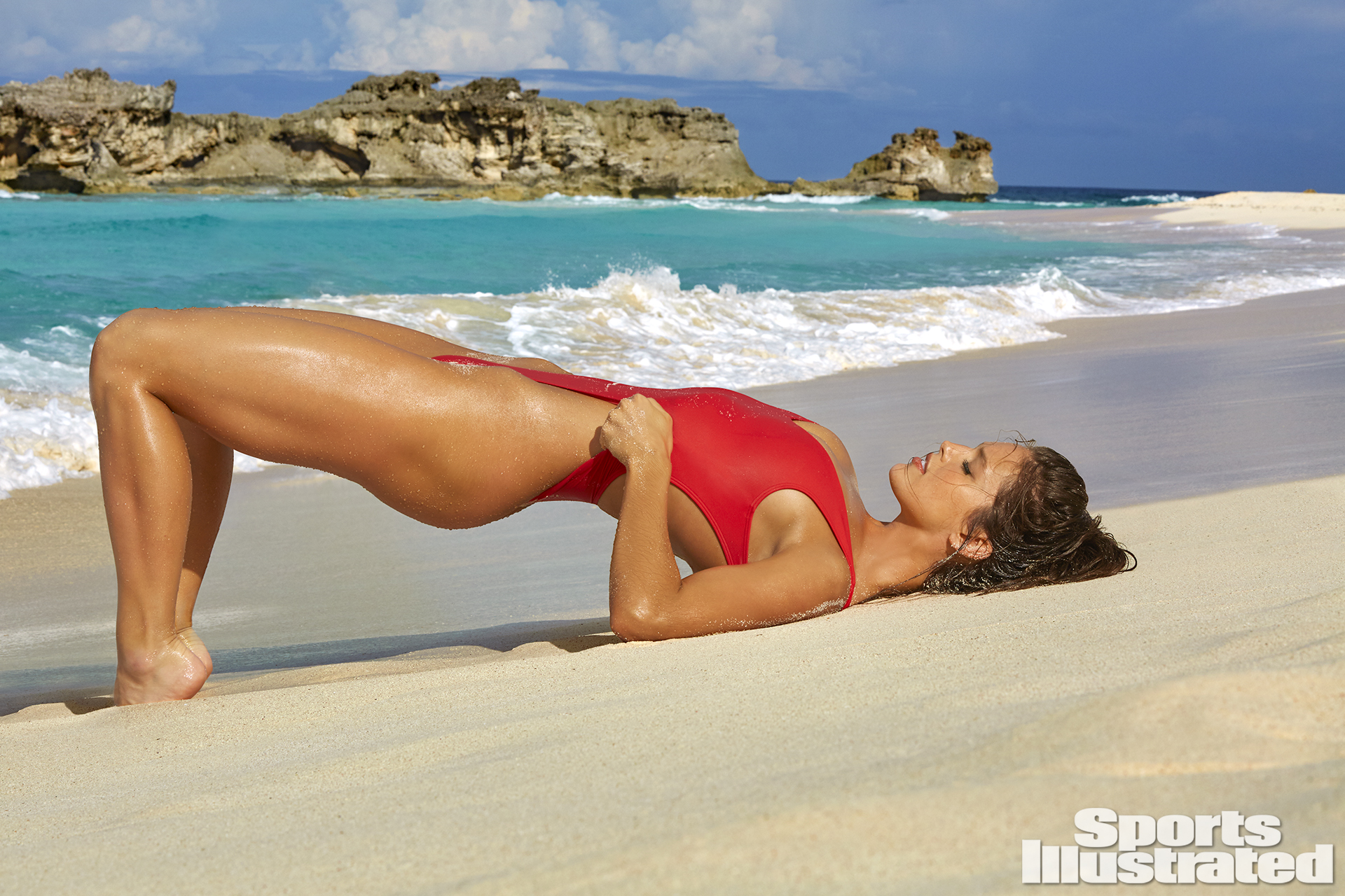 Emily DiDonato was photographed by James Macari in Turks & Caicos. Swimsuit by Kovey.