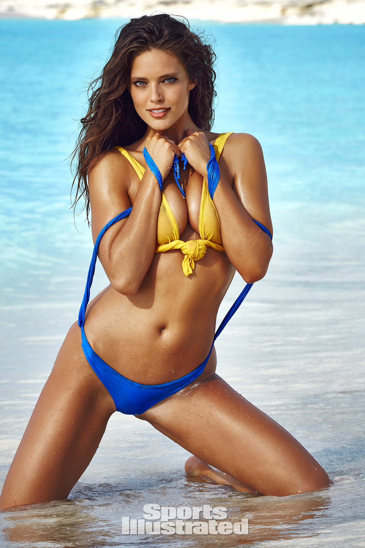 Emily DiDonato was photographed by James Macari in Turks & Caicos. Top by FRAME Denim. Swimsuit by MIKOH.