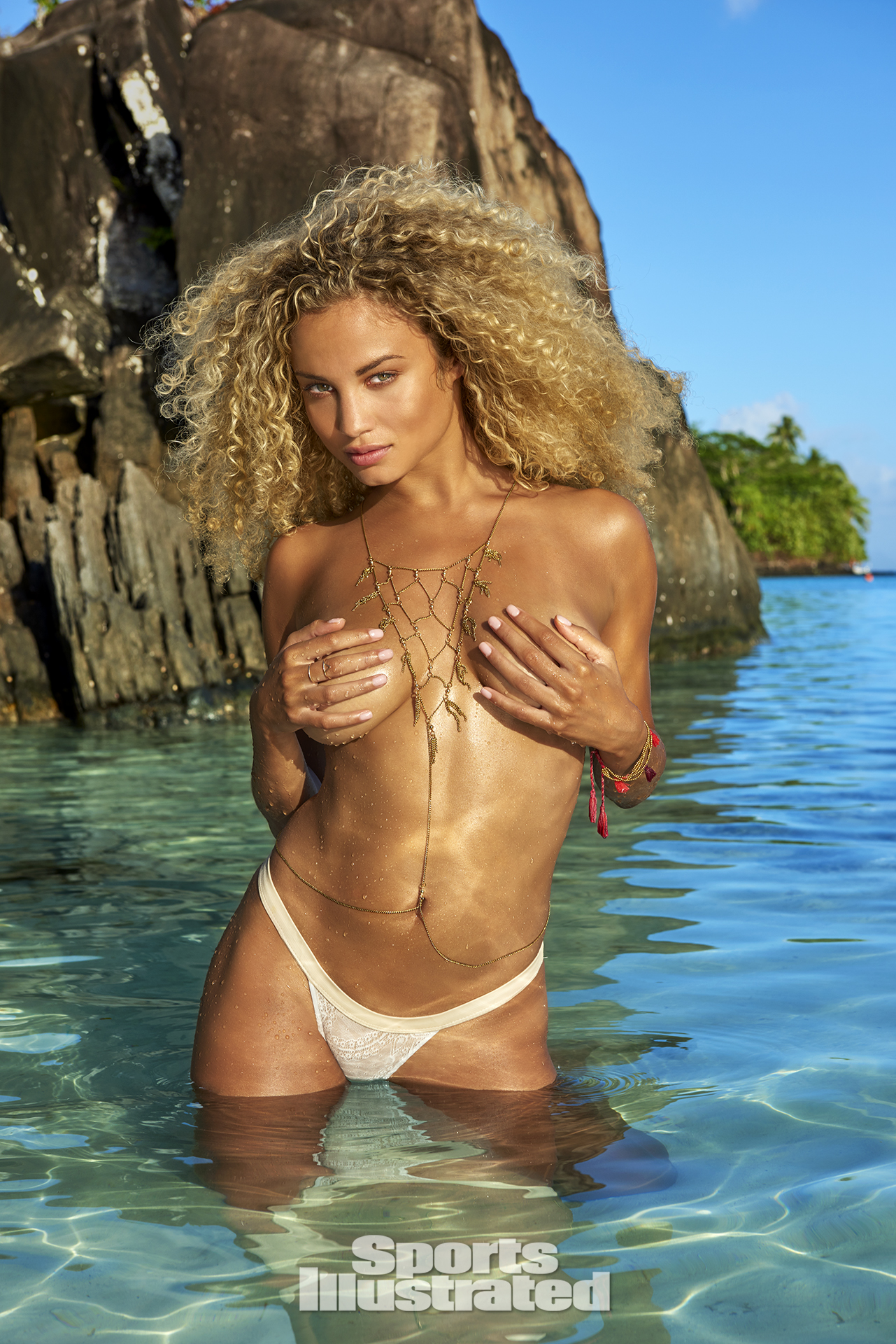 Rose Bertram was photographed by Yu Tsai in The Islands Of Tahiti. Swimsuit by INDAH.