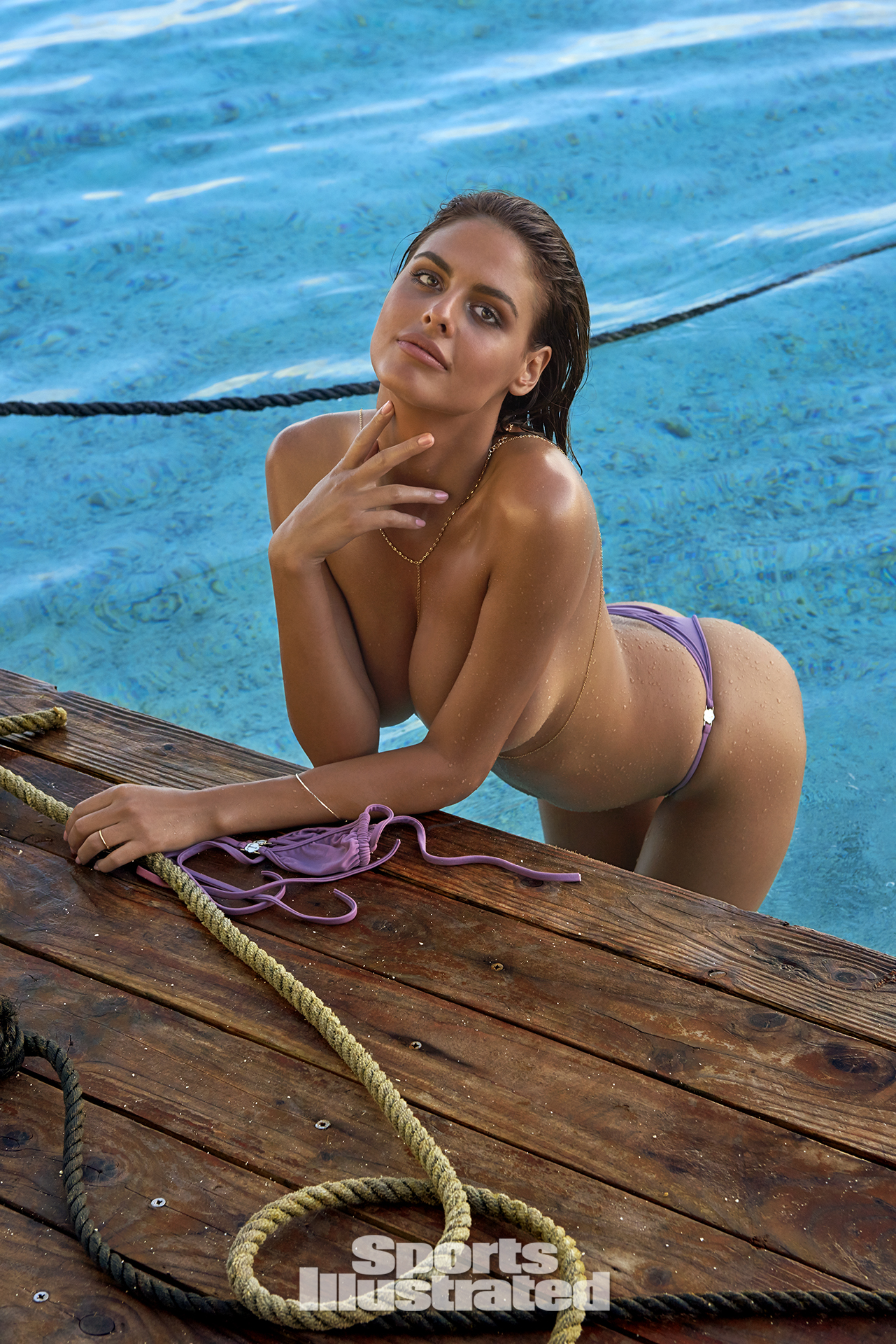 Bo Krsmanovic was photographed by Yu Tsai in The Islands Of Tahiti. Swimsuit by TeenyB Bikini Couture.
