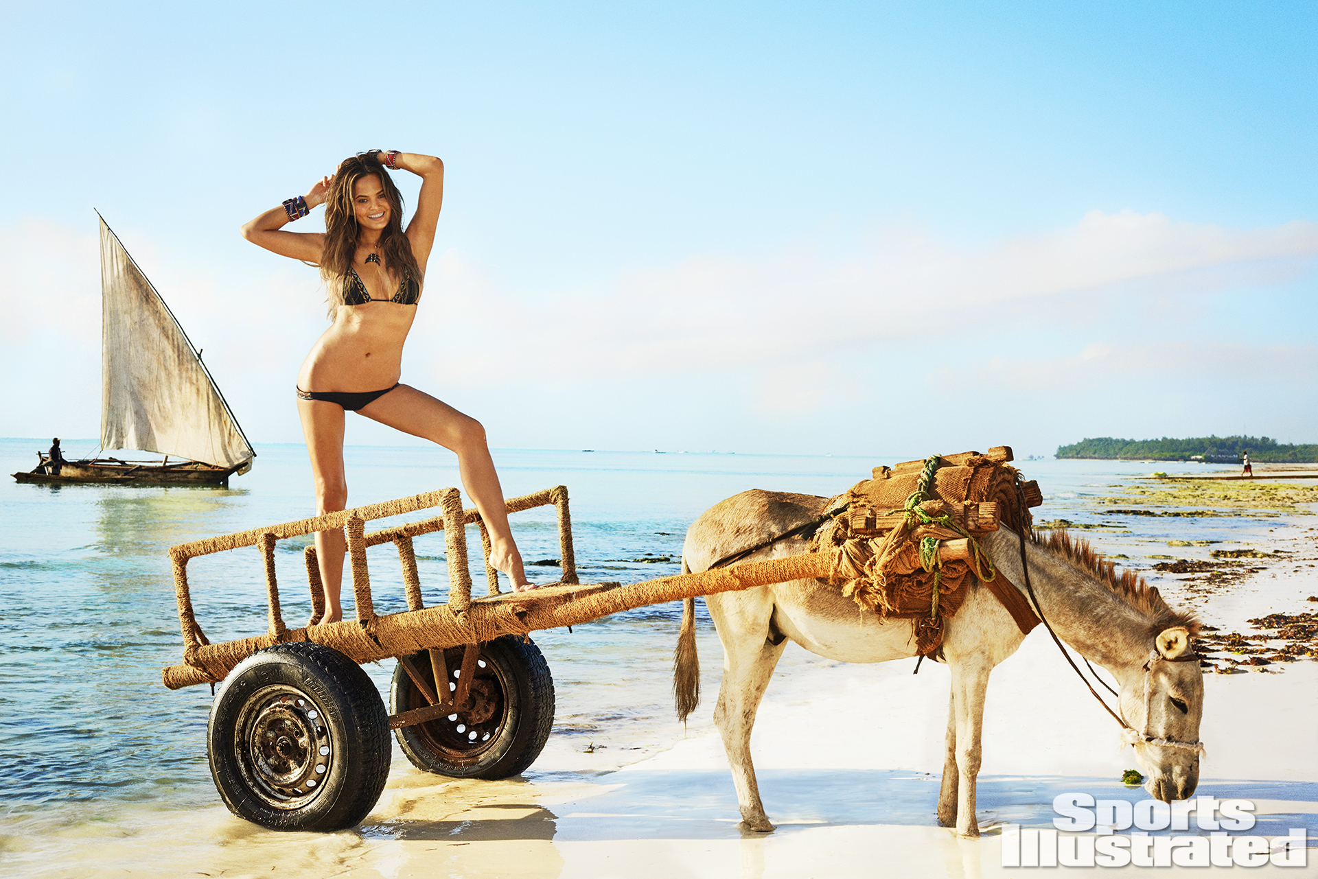 Chrissy Teigen was photographed by Ruven Afanador in Zanzibar. Swimsuit by L*SPACE By Monica Wise.