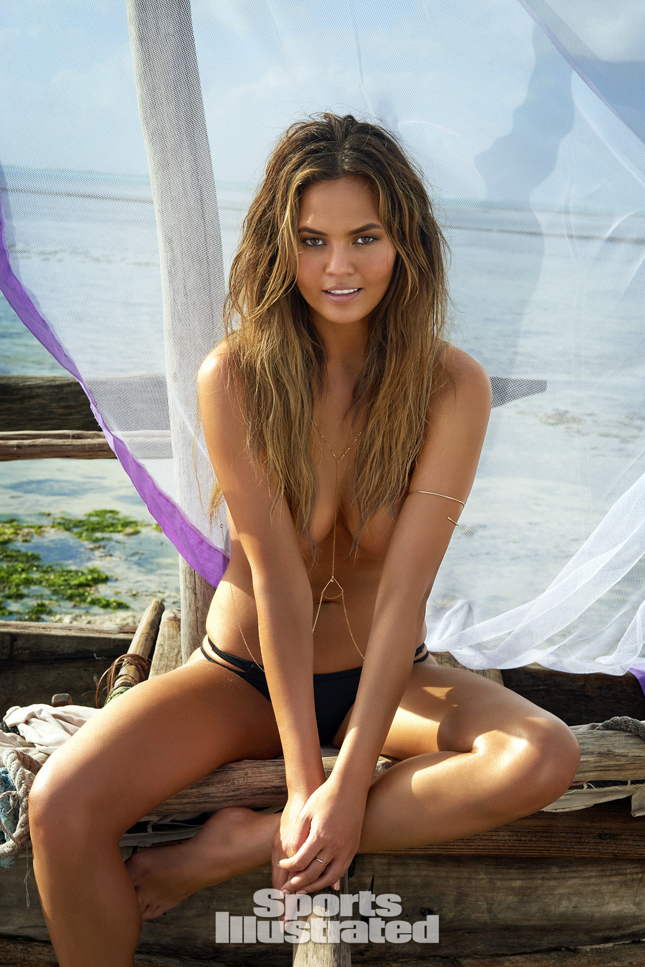 Chrissy Teigen was photographed by Ruven Afanador in Zanzibar. Swimsuit by MIKOH.