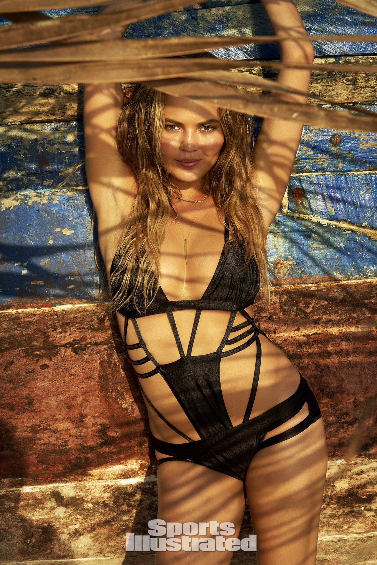 Chrissy Teigen was photographed by Ruven Afanador in Zanzibar. Swimsuit by Jiri Kalfar.