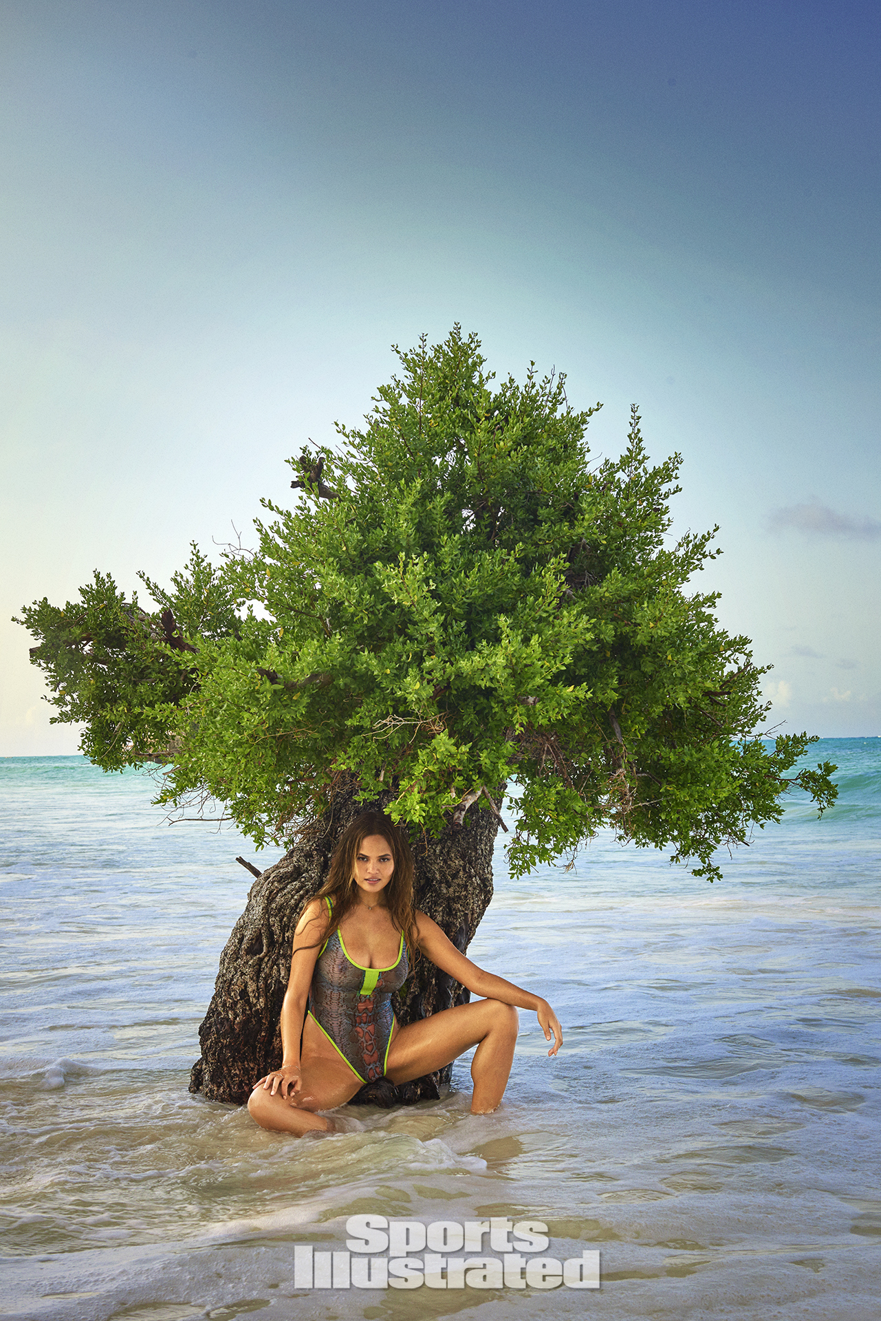 Chrissy Teigen was photographed by Ruven Afanador in Zanzibar. Swimsuit by Haus Of PinkLemonaid.