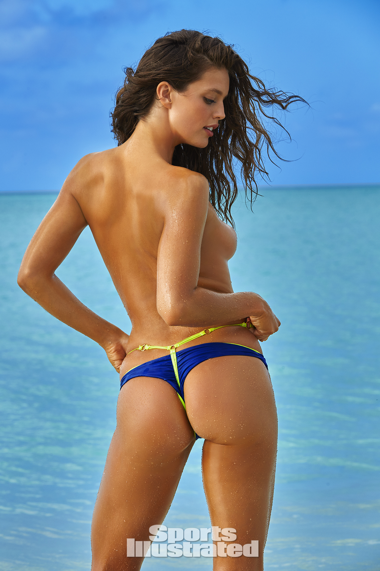 Emily DiDonato was photographed by James Macari in Turks & Caicos. Swimsuit by Basta Surf & KASS SWIMWEAR.