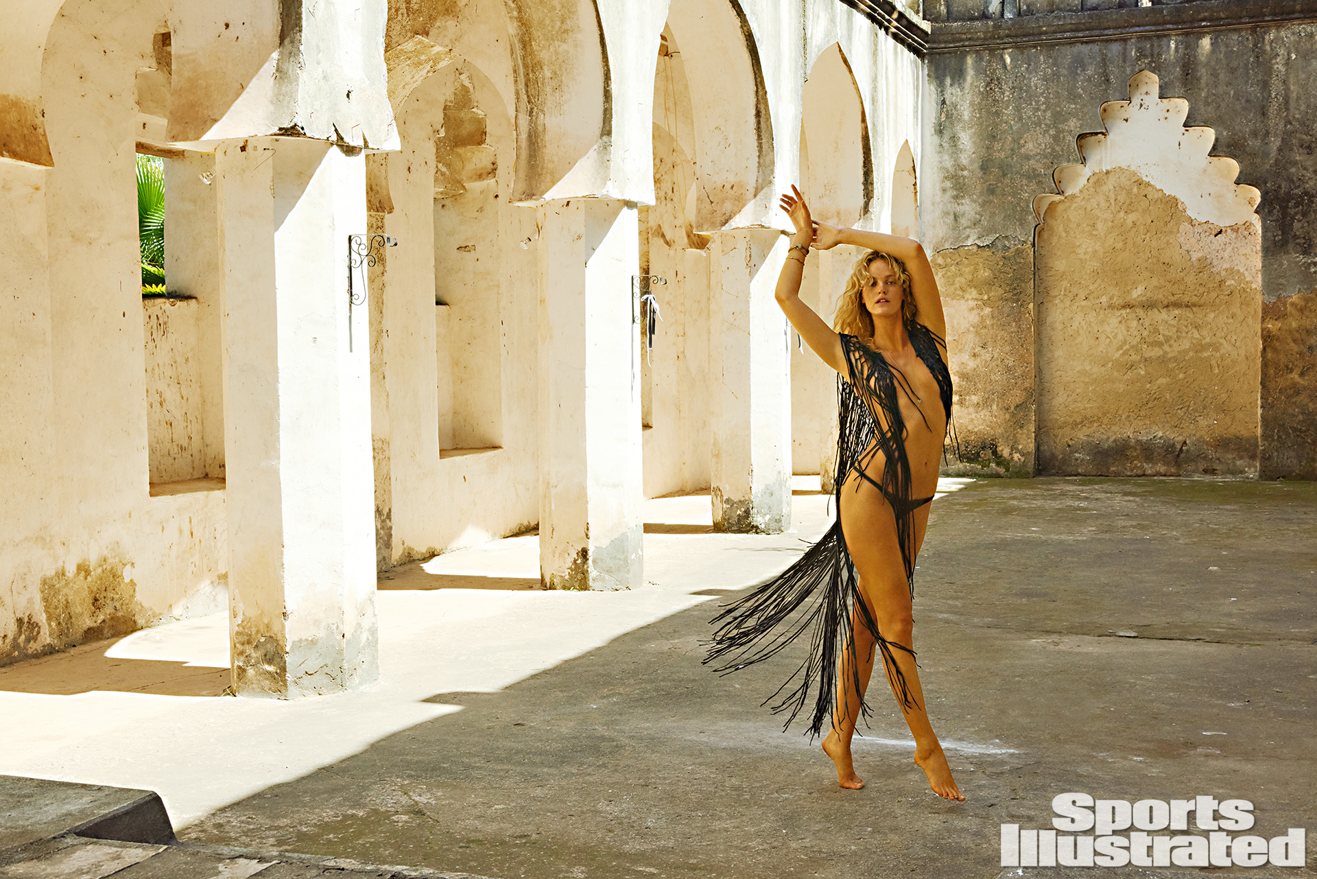 Erin Heatheron was photographed by Ruven Afanador in Zanzibar. Top by Lost Art by Jordan Betten. Swimsuit by INDAH.