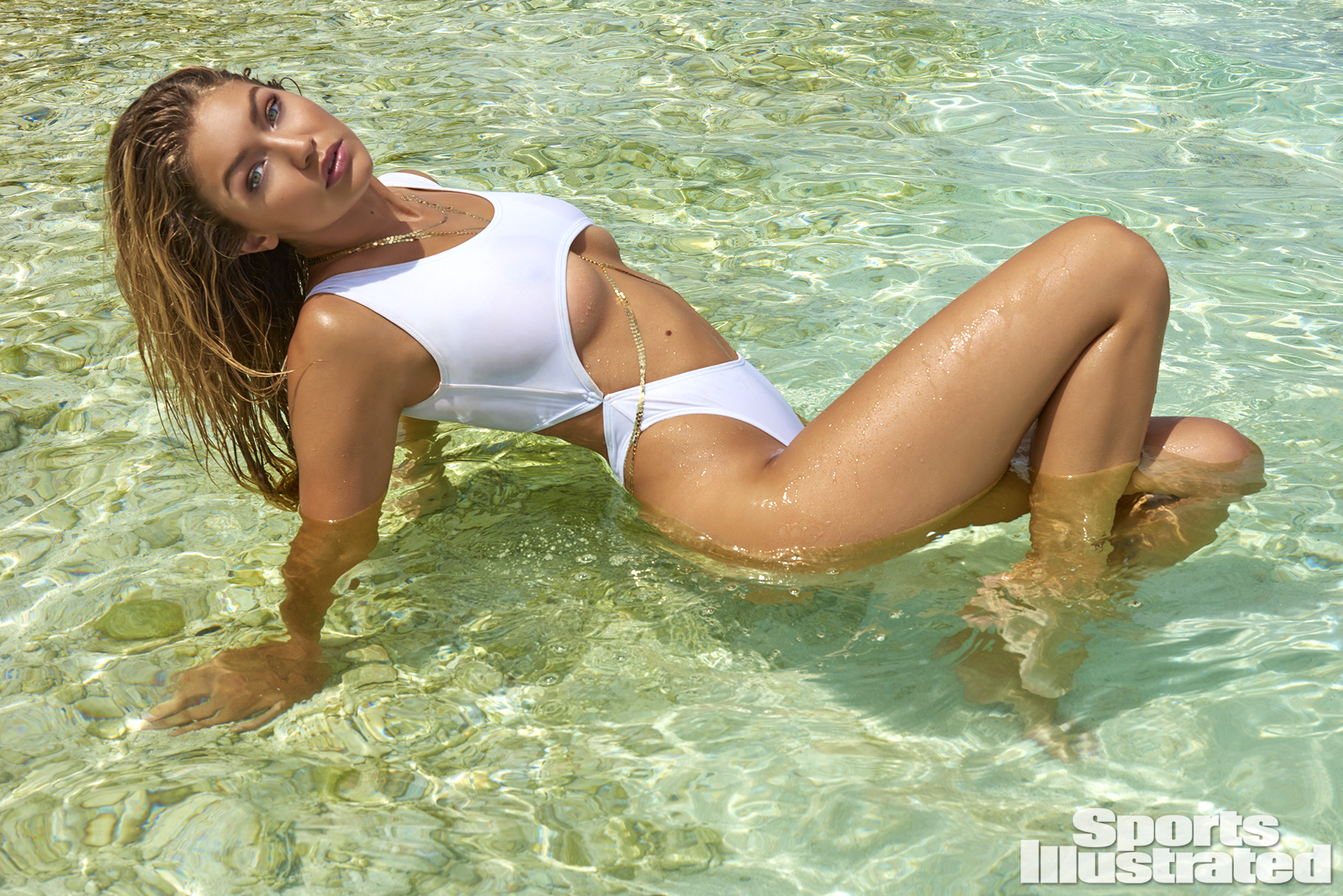 Gigi Hadid was photographed by Yu Tsai in The Islands Of Tahiti. Swimsuit by Lola & Lamar.