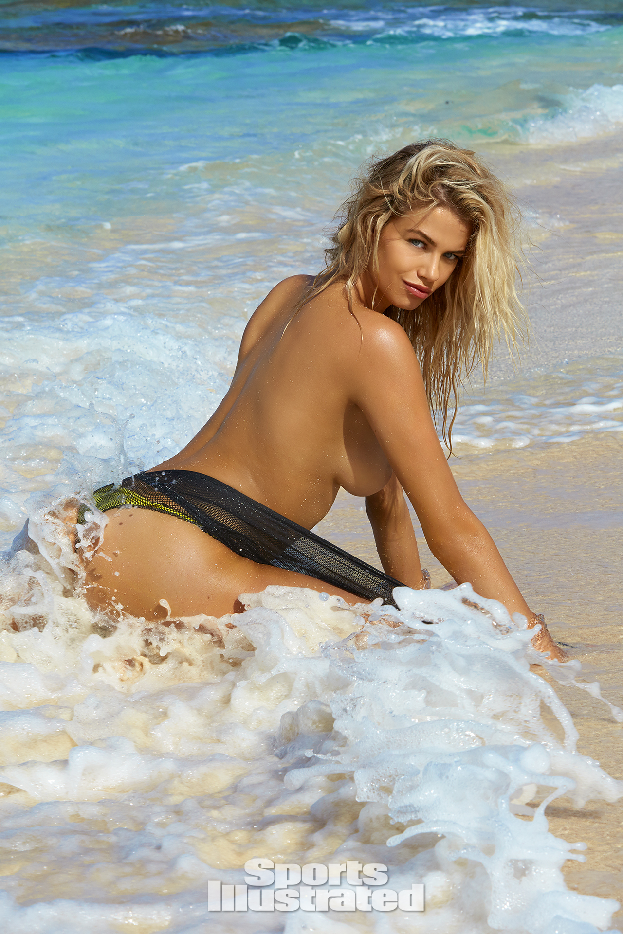 Hailey Clauson was photographed by James Macari in Turks & Caicos. Top by Diesel. Swimsuit by Noe Garments.