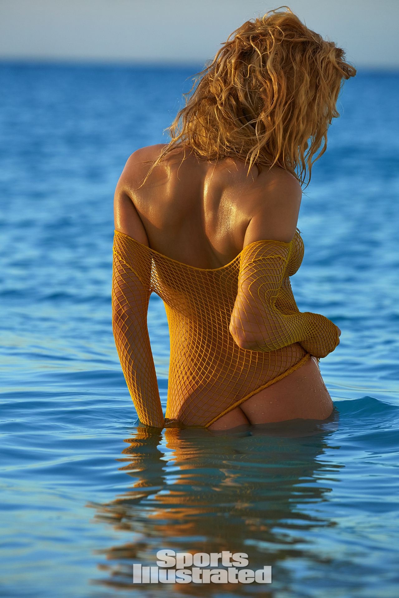 Hailey Clauson was photographed by James Macari in Turks & Caicos. Top by We Love Colors.