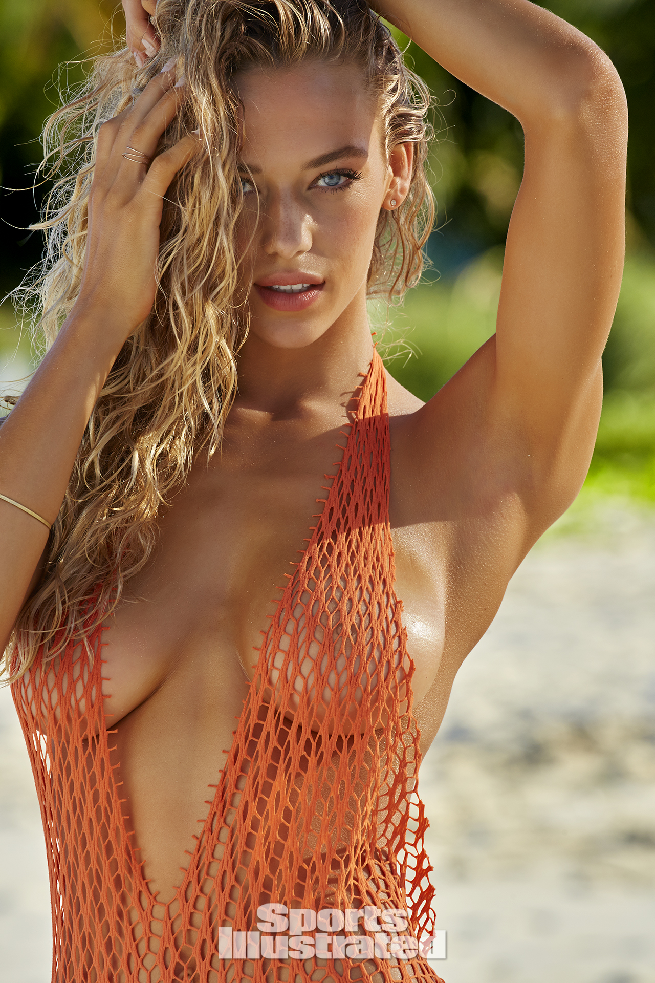 Hannah Ferguson was photographed by James Macari in Turks & Caicos. Swimsuit by Hayhay Couture By Hayley Kaysing.