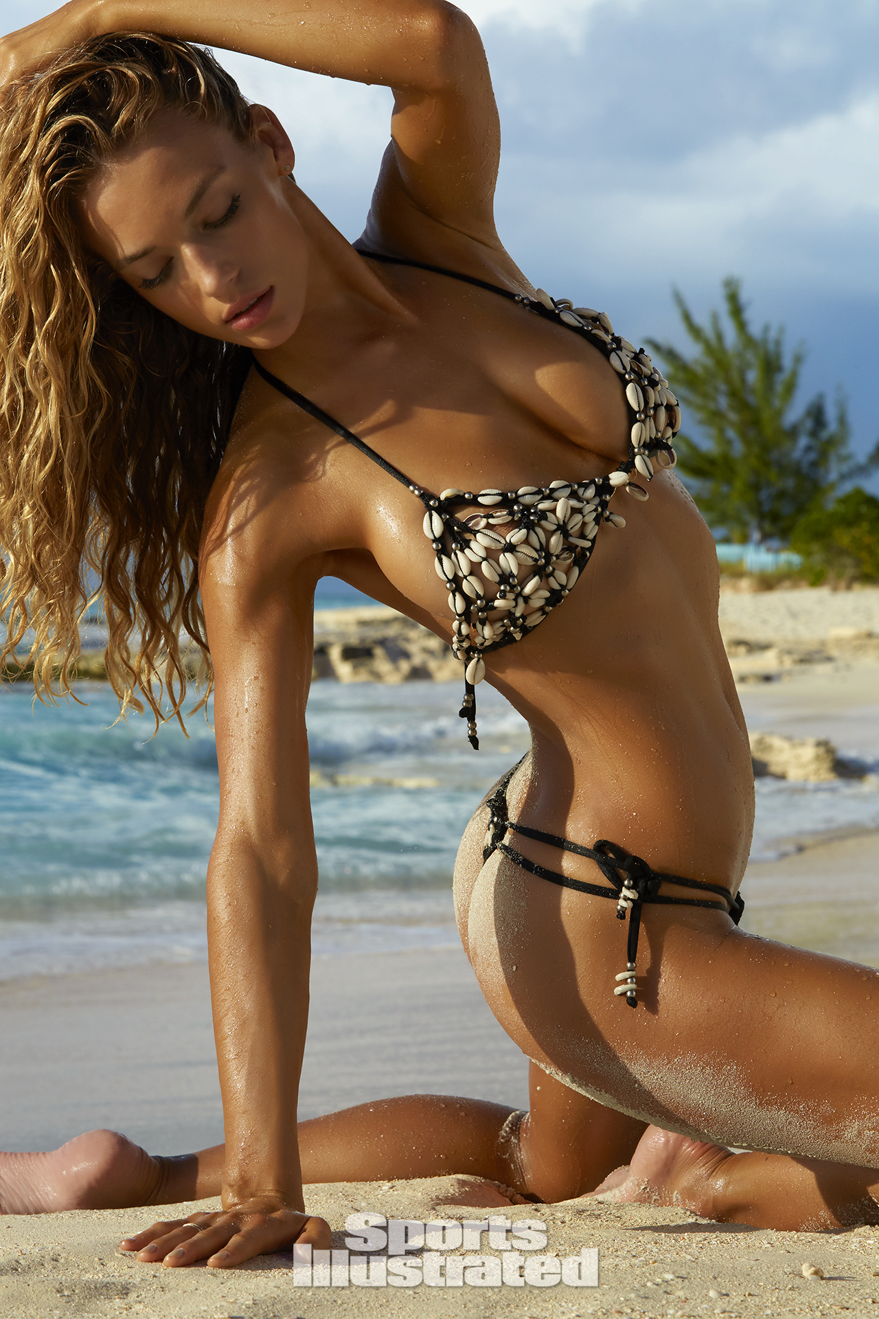 Hannah Ferguson was photographed by James Macari in Turks & Caicos. Swimsuit by Heidi Fish.