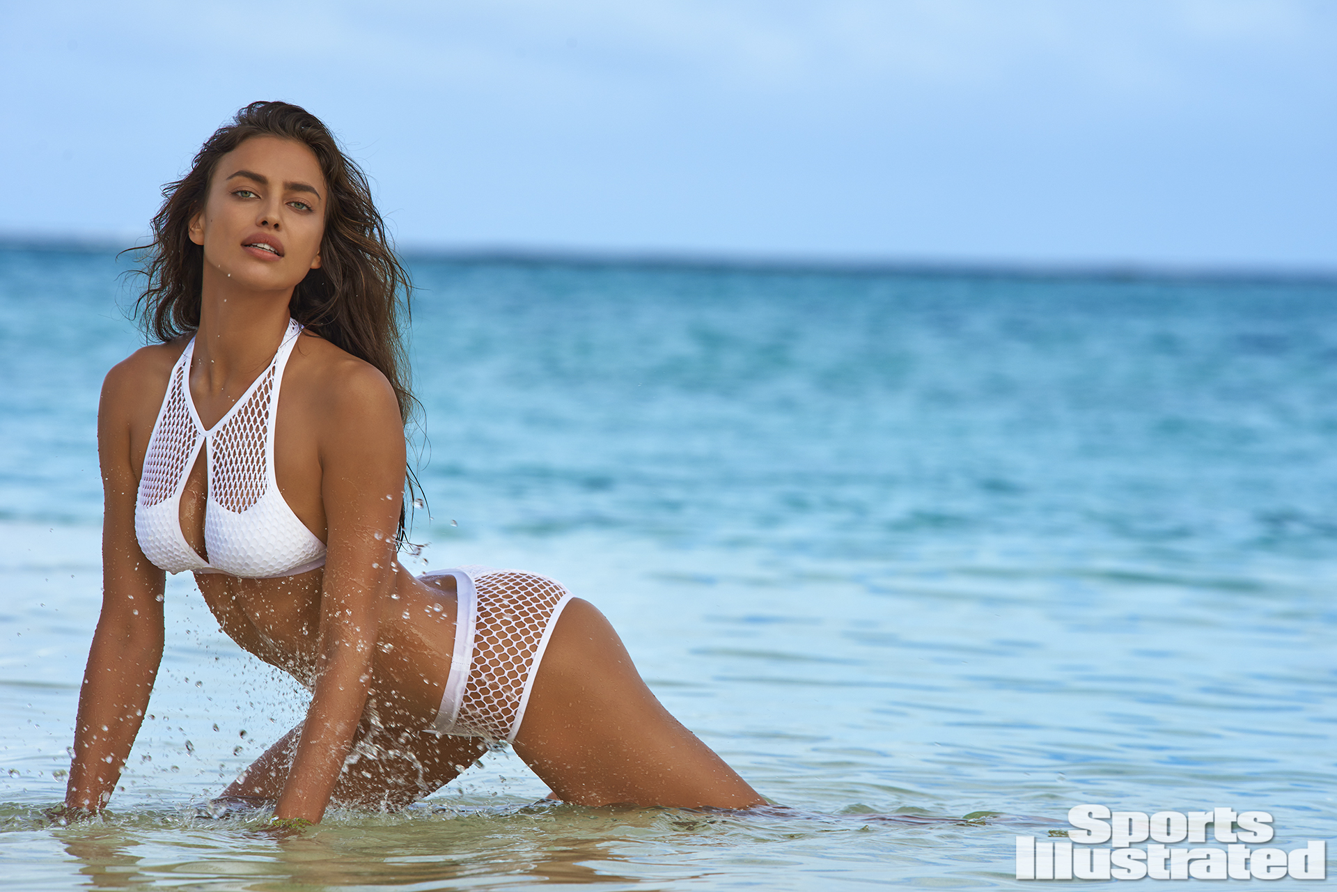 Irina Shayk was photographed by Yu Tsai in The Islands Of Tahiti. Swimsuit by Blue Life Swim.