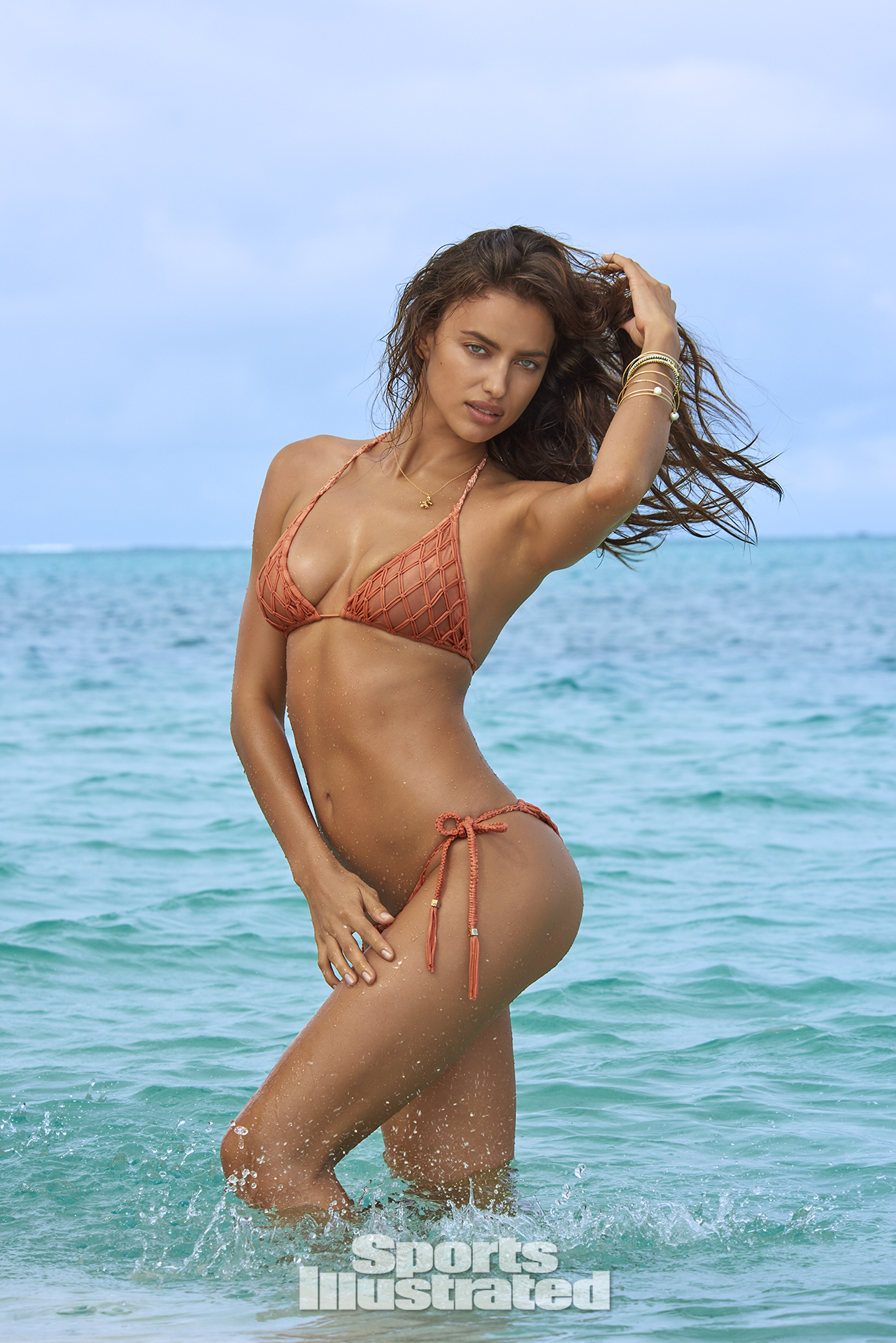 Irina Shayk was photographed by Yu Tsai in The Islands Of Tahiti. Swimsuit by SINESIA KAROL.