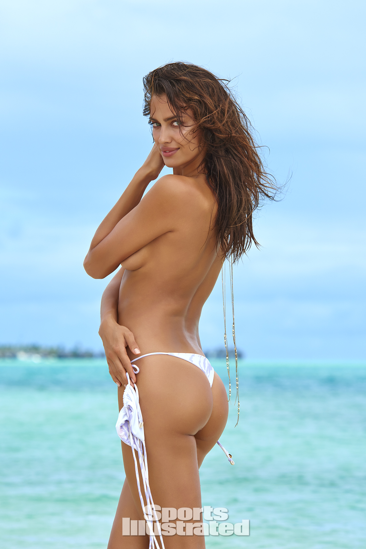 Irina Shayk was photographed by Yu Tsai in The Islands Of Tahiti. Swimsuit by INDAH.