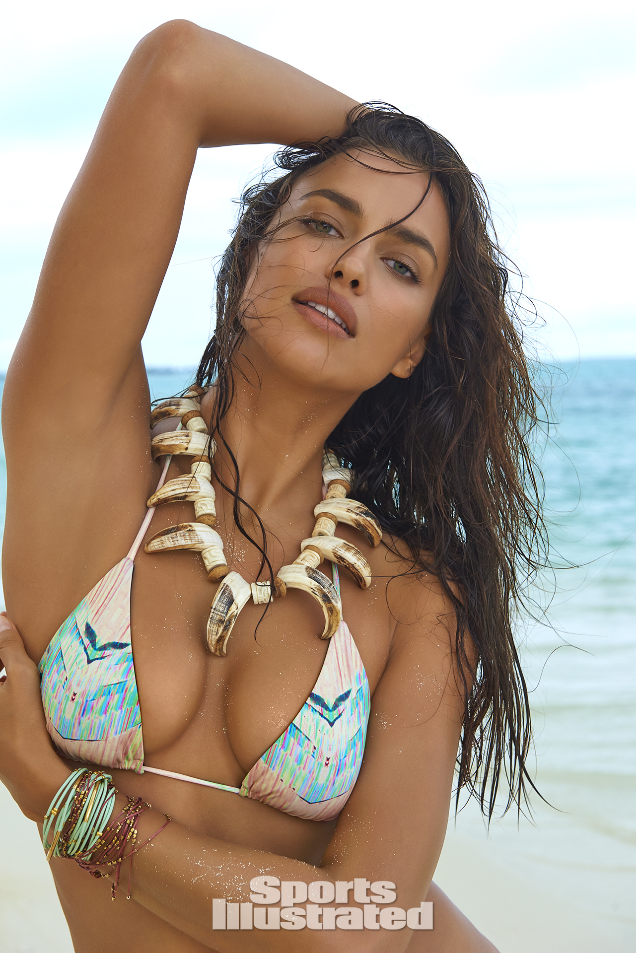 Irina Shayk was photographed by Yu Tsai in The Islands Of Tahiti. Swimsuit by TAVIK.