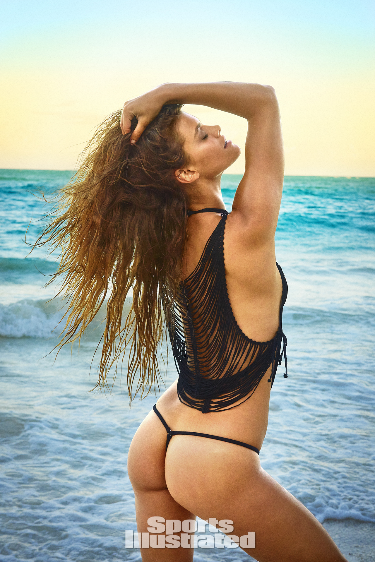 Nina Agdal was photographed by Ruven Afanador in Zanzibar. Top by La Perla. Swimsuit by TeenyB Bikini Couture.
